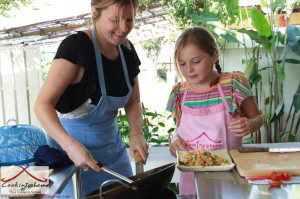 Family learning to cook Thai food